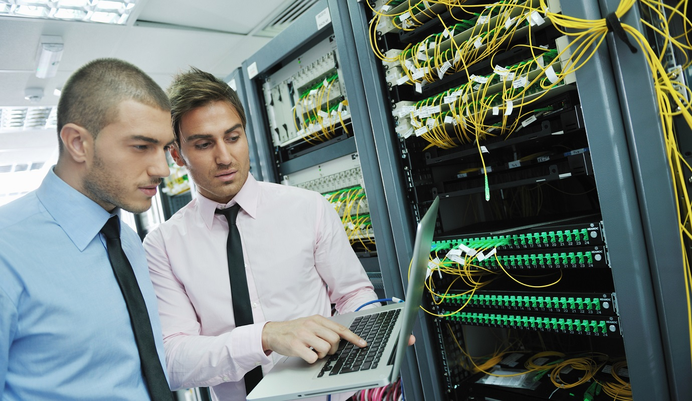 IT engineers solving problems in network server