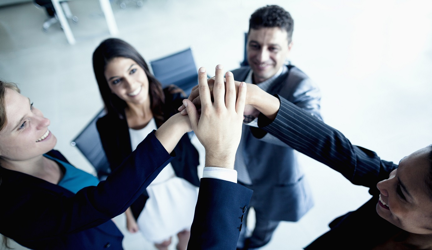Business people cheering with hands together